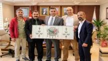 Başkan Turan'a tebrik ziyaretleri sürüyor